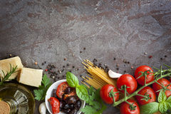 Italian Food Background. With variety of ingredients over slate background Stock Photography