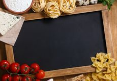 Italian food with chalkboard Stock Photography