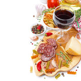Italian food - cheese, sausage, pasta, spices and wine isolated Royalty Free Stock Image