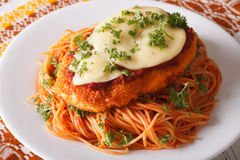Italian food: Chicken Parmigiana and spaghetti closeup. horizontal. Italian food: Chicken Parmigiana and spaghetti close up on a plate on the table. horizontal royalty free stock photos