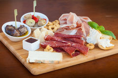 Italian food on chopping board Royalty Free Stock Photos
