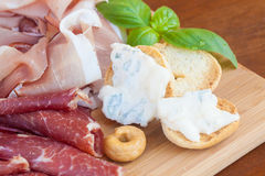 Italian food on chopping board Stock Photo
