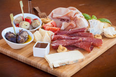 Italian food on chopping board stock images