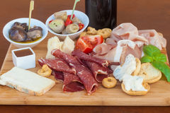 Italian food on chopping board Royalty Free Stock Image