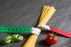 Italian food concept with centimeter flag and pasta. Closeup Stock Images