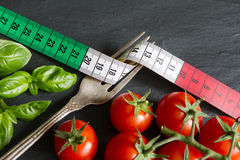 Italian food concept with centimeter tomato and basil Stock Photography