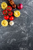 Italian food concept pasta ingredients on grey stone desk background top view copyspace Royalty Free Stock Image