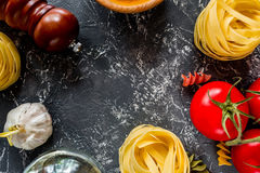 Italian food concept pasta ingredients on grey stone desk background top view copyspace close up Stock Images