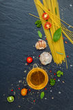 Italian food concept. Spaghetti with ingredients sweet basil ,to Stock Photos