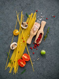 Italian food concept. Spaghetti with ingredients sweet basil ,to Stock Image
