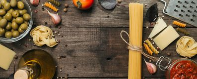 Fettuccine and spaghetti with ingredients for cooking pasta. Top view with space for text royalty free stock images