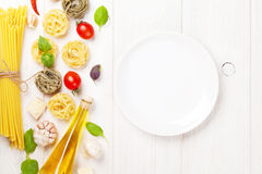 Italian food cooking ingredients and empty plate Stock Images
