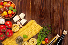 Italian food cooking ingredients. Pasta, tomatoes, basil Royalty Free Stock Photo