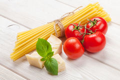 Italian food cooking ingredients. Pasta, tomatoes, basil Stock Photography