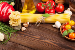 Italian food cooking ingredients. Pasta, tomatoes, basil Stock Images