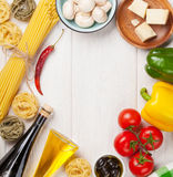 Italian food cooking ingredients. Pasta, tomatoes, peppes Stock Image