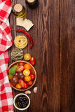 Italian food cooking ingredients. Pasta, vegetables, spices Stock Images