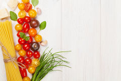 Italian food cooking ingredients. Pasta, vegetables, spices Royalty Free Stock Photography