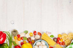 Italian food cooking ingredients. Pasta, vegetables, spices Stock Image