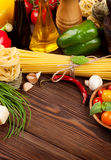 Italian food cooking ingredients. Pasta, vegetables, spices Royalty Free Stock Photos