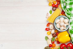 Italian food cooking ingredients. Pasta, vegetables, spices Royalty Free Stock Image