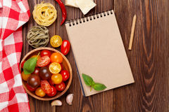 Italian food cooking ingredients. Pasta, vegetables, spices Stock Photos