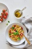 Italian food: Fusilli pasta salad with italian dressing. Italian food. Flat lay of fusilli pasta salad with italian dressing, tomatoes, broccoli and basil leaves stock photos