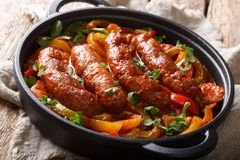 Free Italian Food Grilled Sausage With Grilled Peppers, Onions, Herbs And Tomatoes Closeup In A Frying Pan. Horizontal Stock Images - 146780974