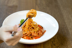Italian food hand holding fork with spaghetti bolognese in white Royalty Free Stock Photography