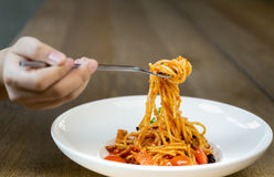 Italian food hand holding fork with spaghetti bolognese in white Royalty Free Stock Photos