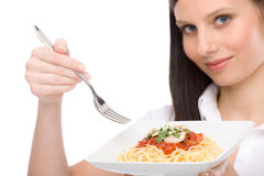 Italian food - healthy woman eat spaghetti sauce Stock Photos