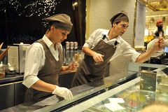Italian food: icecream famous shop Venchi in Florence , Italy. With young workers Royalty Free Stock Image