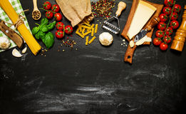 Italian food or ingredients background with fresh vegetables, pa Royalty Free Stock Images