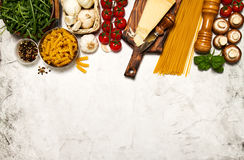 Italian food or ingredients background with fresh vegetables, pa. Sta, cheese parmesan and spices. Top view, view from above. Copy space royalty free stock photo