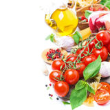 Italian Food Ingredients - Cherry Tomatoes, Basil And Pasta Stock Photo