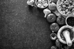 Italian food ingredients on dark stone background stock photo