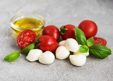 Italian food ingredients. Mozzarella, basil, tomatoes stock photos