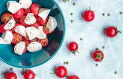 Italian food ingredients - mozzarella, tomatoes on concrete. view from above stock image