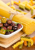 Italian food ingredients - pasta and olives Royalty Free Stock Photo