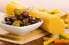 Italian food ingredients - pasta and olives Stock Images