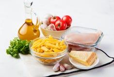 Italian food ingredients: pasta, tomatoes, chicken Royalty Free Stock Photos