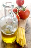 Italian food ingredients spaghetti and olive oil Royalty Free Stock Images