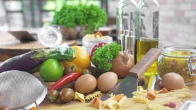 Italian food ingredients on wooden background. Food composition pasta, macaroni, vegetables, oil, spices on kitchen