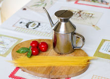 Italian Food. Italin food, oil,pasta, tomatoes and basil Royalty Free Stock Photos