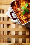 Italian Food. Lasagna plate on wooden table. Stock Photography