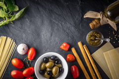Italian food  mix on the black stone table top view Royalty Free Stock Photo