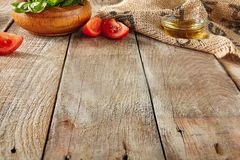 Italian Food on Old Wooden Background with Selective Focus. Table Top Perspective with Tomatoes, Basil and Olive Oil with Place for Text. Blurred Vintage Aged stock image