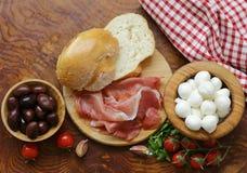 Italian food - olives, parma ham, tomatoes, mozzarella Stock Image