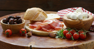 Italian food - olives, parma ham, tomatoes, mozzarella Royalty Free Stock Image