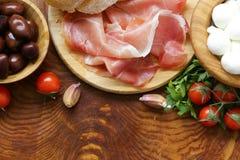 Italian food - olives, parma ham, tomatoes, mozzarella Royalty Free Stock Photos